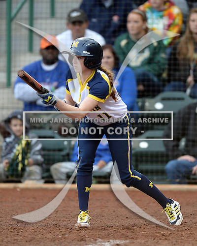 Michigan Wolverines outfielder Lyndsay Doyle (11) at bat during the season opener against the Florida Gators on February 8, 2014 at the USF Softball Stadium in Tampa, Florida.  Florida defeated Michigan 9-4 in extra innings.  (Copyright Mike Janes Photography)