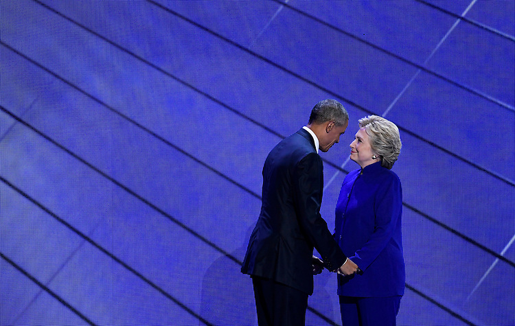 UNITED STATES - JULY 27: Democratic nominee Hillary Clinton joins President Barack Obama on stage after his speech to the Democratic National Convention in Philadelphia on Wednesday, July 27, 2016. (Photo By Bill Clark/CQ Roll Call)