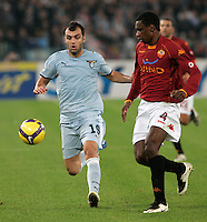 Calcio, Serie A: Roma vs Lazio. Roma, stadio Olimpico, 16 novembre 2008. .Football, Italian serie A: Roma vs Lazio. Rome, Olympic stadium, 16 november 2008..Lazio forward Goran Pandev, of Macedonia, left, is challenged by AS Roma Brazilian defender Juan..UPDATE IMAGES PRESS/Riccardo De Luca
