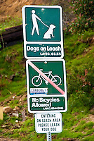 Dogs on Leash, No Bicycles allowed, Architectural, Signage, Way finding Systems, stamped out of metal, lettering embossed, printed,