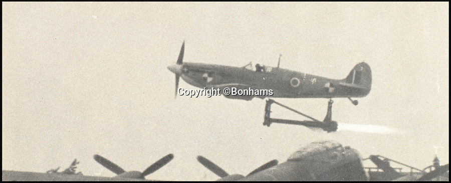 BNPS.co.uk (01202 558833)<br /> Pic: Bonhams/BNPS<br /> <br /> Eric Brown trialling a Firefly plane in 1943 with a jet engine attached to it.<br /> <br /> The historic medals and logbooks of legendary test pilot Eric 'Winkle' Brown have been saved for the nation and will be displayed in a British museum.<br /> <br /> A deal has been secured for the hero's prestigious decorations and all his flying journals after they failed to sell at auction earlier this week.<br /> <br /> They had been expected to sell for &pound;200,000, possibly to an overseas buyer, but bidding only reached &pound;140,000, falling short of the reserve price.<br /> <br /> Now it has emerged that the National Museum of the Royal Navy has negotiated a deal with Captain Brown's family to buy his stunning archive.