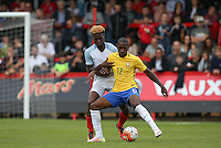 Gerson of Brazil & Joshua Onomah (Tottenham Hotspur) of England in action during the International match between England U20 and Brazil U20 at the Aggborough Stadium, Kidderminster, England on 4 September 2016. Photo by Andy Rowland / PRiME Media Images.