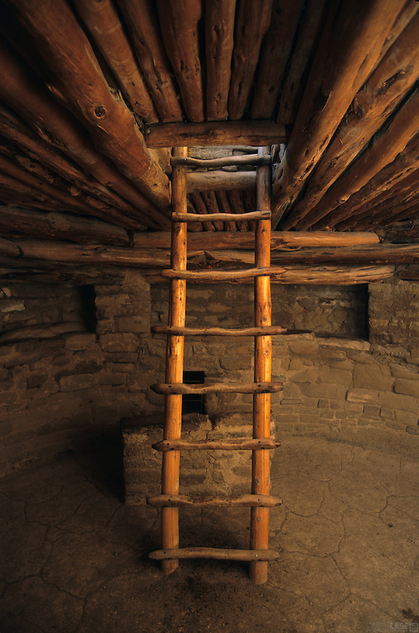 The interior of a kiva in Mesa Verde National Park, Colorado, is illuminated by exterior light.