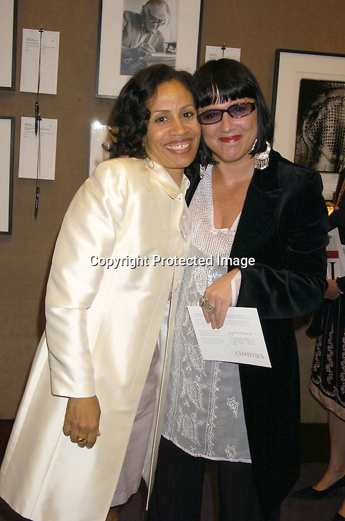 Taina Bien-Aime and Eve Ensler ..at a Photography Auction to Benefit Equality Now on June 20, 2005 at Christies. ..Photo By Robin Platzer, Twin Images