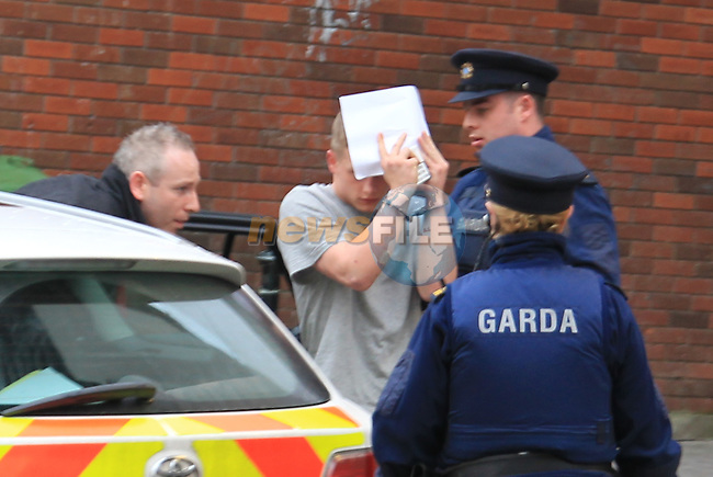 Jamie Gallagher, being led into Drogheda District court where he was charged in relation to the stabbing of a 16 year old school boy at Laurence street in Drogheda, he was remanded in custody..Picture: Fran Caffrey/www.newsfile.ie.