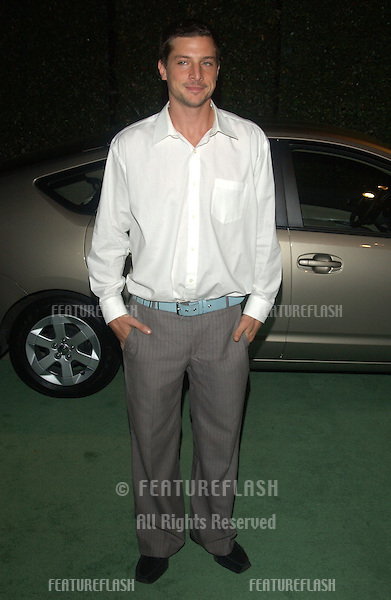 Actor SIMON REX at the 13th Annual Environmental Media Awards in Los Angeles..November 5, 2003