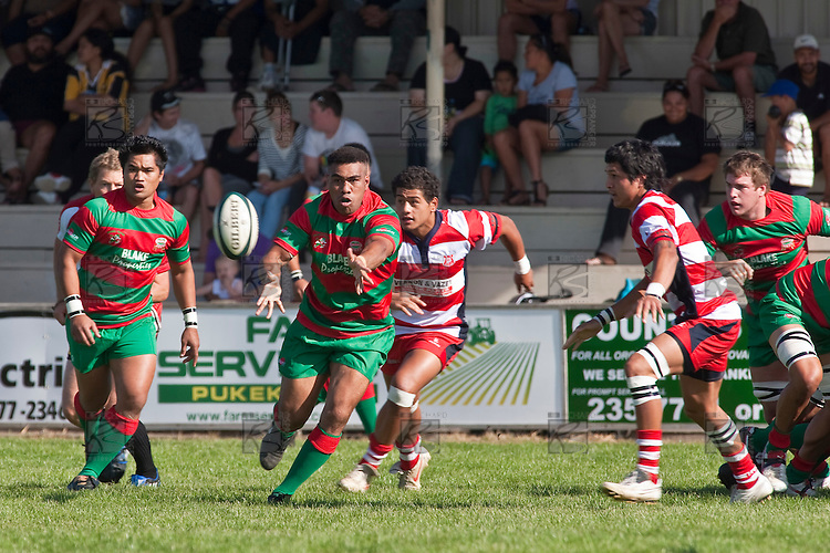 Tevita Finau passes to the backs after makuing a run from the back of a ruck. Counties Manukau Premier Club Rugby game bewtween Waiuk & Karaka played at Waiuku on Saturday April 11th, 2010..Karaka won the game 24 - 22 after leading 21 - 9 at halftime.