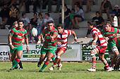 Tevita Finau passes to the backs after makuing a run from the back of a ruck. Counties Manukau Premier Club Rugby game bewtween Waiuk & Karaka played at Waiuku on Saturday April 11th, 2010..Karaka won the game 24 - 22 after leading 21 - 9 at halftime.