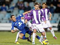 Getafe's Abdel Barrada (l) and Real Valladolid's Victor Perez during La Liga match.November 18,2012. (ALTERPHOTOS/Acero)
