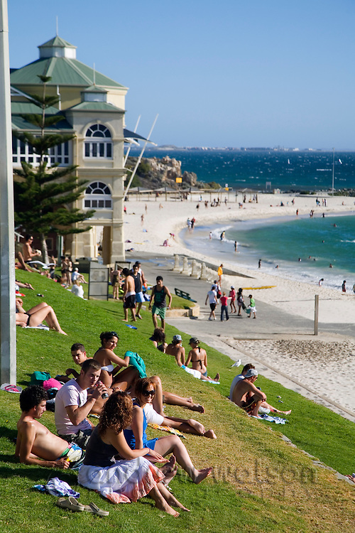 Sunbathers on the grassy slopes at Cottesloe Beach. Perth, Western Australia, AUSTRALIA.