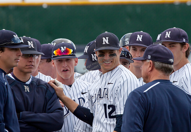 March 29, 2012:  Nevada Wolf Pack heads coach Gary Powers (right) talks with his team before their NCAA baseball game against BYU Cougars played at Peccole Park on Thursday afternoon in Reno, Nevada.