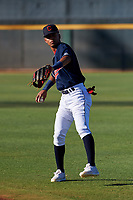 AZL Indians Red Yordys Valdes (10) warms up before an Arizona League game against the AZL Padres 1 on June 23, 2019 at the Cleveland Indians Training Complex in Goodyear, Arizona. AZL Indians Red defeated the AZL Padres 1 3-2. (Zachary Lucy/Four Seam Images)