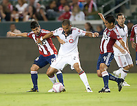 Toronto FC forward Maicon Santos (29) splits the Chivas USA players Paulo Nagamura (26) and Michael Umana (4) during the first half of the game between Chivas USA and Toronto FC at the Home Depot Center in Carson, CA, on October 9, 2010. Final score Chivas USA 3, Toronto FC 0.