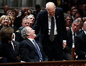Former Sen. Alan Simpson, R-Wyo, center, speaks with former President George Bush, right, as he walks to a podium to speak during the State Funeral for former President George H.W. Bush at the National Cathedral, Wednesday, Dec. 5, 2018, in Washington.<br /> Credit: Alex Brandon / Pool via CNP
