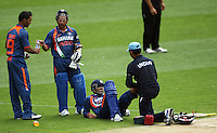 India's Dinesh Karthik bring drink out to Sachin Tendulkar as Virender Sehwag has his leg massaged during the 2nd ODI cricket match between the New Zealand Black Caps and India at Westpac Stadium, Wellington, New Zealand on Friday, 6 March 2009. Photo: Dave Lintott / lintottphoto.co.nz