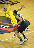 Everard Bartlett knocks down Patty Mills during the FIBA Oceania men's tournament basketball match between New Zealand and Australia at TSB Bank Arena, Wellington, New Zealand on Tuesday, 18 August 2015. Photo: Dave Lintott / lintottphoto.co.nz