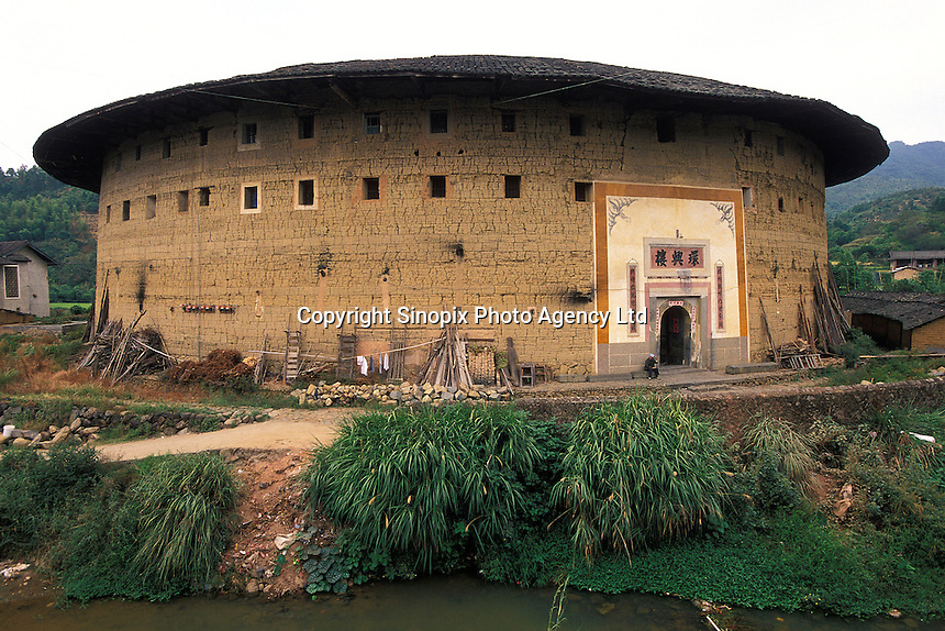 Traditional Hakka Roundhouse, fort-like home to dozens of families, often several hundreds of years old in Fujian, China. .