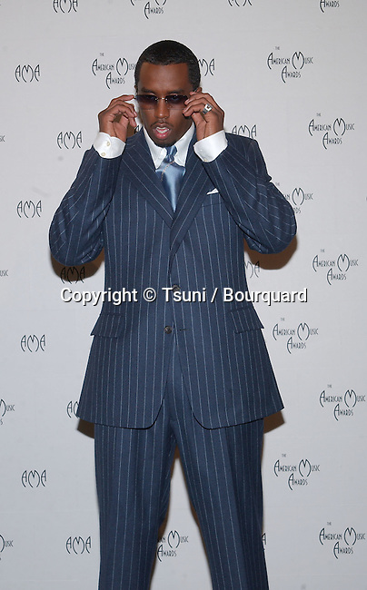 """Sean """"P.Diddy"""" Combs at the 29th Annual American Music Awards at the Shrine Auditorium in Los Angeles Wednesday, Jan. 9, 2002. He was co-host of the show.           -            Sean""""PDiddy""""Combs12.jpg"""