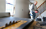WATERBURY CT. 11 December 2018-121018SV11-Pete Romanello of Waterbury works on a hardwood floor at 23 Kramer Ave. as part of a Habitat for Humanity in Waterbury Tuesday.<br /> Steven Valenti Republican-American