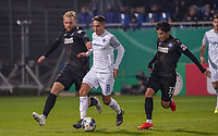 Fabian Schnellhardt (SV Darmstadt 98) gegen Philipp Hofmann (Karlsruher SC), Kyoung-Rok Choi (Karlsruher SC) - 29.10.2019: SV Darmstadt 98 vs. Karlsruher SC, Stadion am Boellenfalltor, 2. Runde DFB-Pokal<br /> DISCLAIMER: <br /> DFL regulations prohibit any use of photographs as image sequences and/or quasi-video.