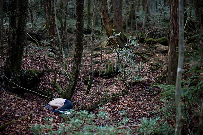 An unidentified man lies dead from an overdose in Aokigahara Jukai forest in Yamanashi Prefecture, Japan on Dec 1 2009. Some medical professionals decry Japan's multi-million-dollar counter-suicide measures saying they turn a blind eye to mental health issues such as depression that are major causes of suicide.