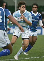 Juan Pablo Socimo of Argentina breaks the Samoan defence during the 7th place play-off at Shaw's Bridge Belfast 2007.
