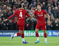 27th November 2019; Anfield, Liverpool, Merseyside, England; UEFA Champions League Football, Liverpool versus SSC Napoli ; Dejan Lovren of Liverpool is congratulated by team mate Virgil van Dijk of Liverpool after scoring the equalising goal - Editorial Use