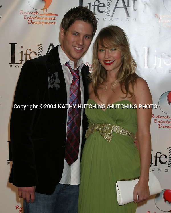 "©2004 KATHY HUTCHINS /HUTCHINS PHOTO.RED PARTY BENEFITING THE ""LIFE THROUGH ART"" FOUNDATION.LOS ANGELES, CA.DECEMBER 4, 2004..ROSS THOMAS.BAELYN NEFF"