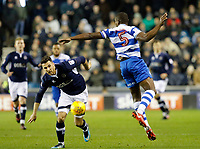 Nedum Onuoha of Queens Park Rangers is beaten by the bounce with Lee Gregory of Millwall in pursuit during the Sky Bet Championship match between Millwall and Queens Park Rangers at The Den, London, England on 29 December 2017. Photo by Carlton Myrie / PRiME Media Images.