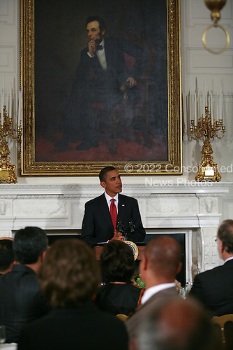 Washington, DC - September 1, 2009 -- United States President Barack Obama hosts a dinner in the State Dining Room of the White House recognizing the religious observance of Ramadan. .Credit: Gary Fabiano - Pool via CNP