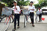 School children in A Luoi, Vietnam push new bicycles given to them by war veteran Mark Oconnor. He recently gave away 55 bicycles to children in the rural highlands district who live too far away from school to attend classes everyday. He plans to return to Vietnam next year and give away at least 200 more bicycles to poor children. April 21, 2014.