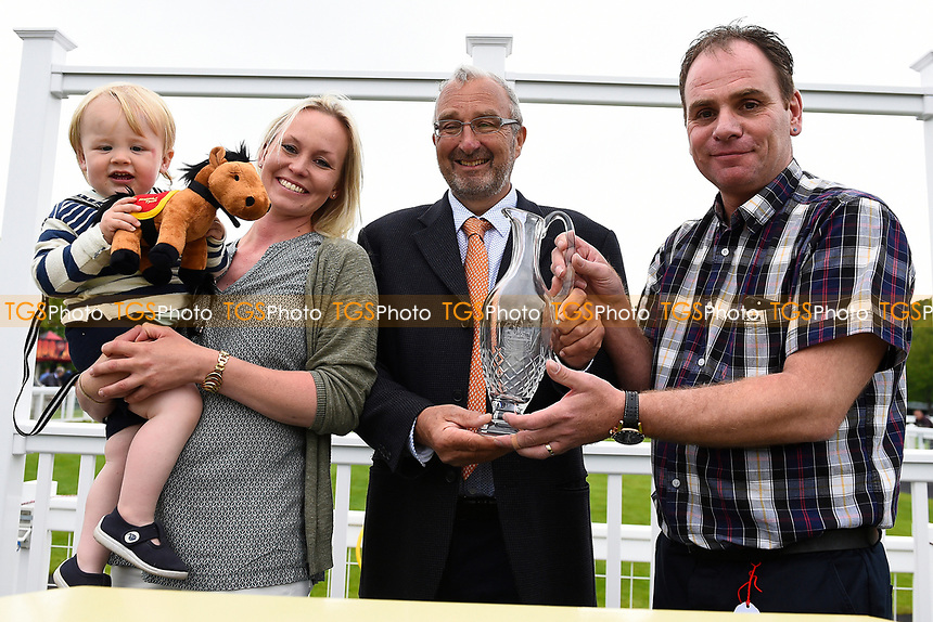 Connections of Nine Below Zero receive their trophy  for winning The Bathwick Tyres EBF Novice Stakes (plus 10) during Evening Racing & Spire FM Does The 80s at Salisbury Racecourse on 27th May 2017