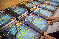"A customer chooses a copy of ""Go Set a Watchman"" by Harper Lee in a Barnes & Noble bookstore in New York on Tuesday, July 14, 2015. The famed Pulitzer Prize winning author Harper Lee's  second novel, ""Go Set A Watchman"" is a sequel to ""To Kill a Mockingbird"" published 50 years ago. Watchman was actually written prior to Mockingbird and was recently found after being thought lost. (© Richard B. Levine)"