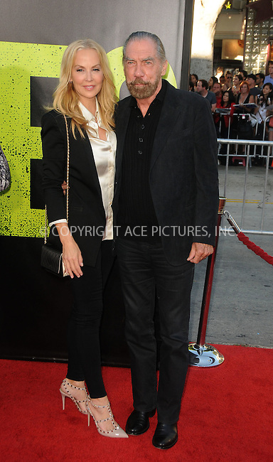 WWW.ACEPIXS.COM . . . . .  ....June 25 2012, LA....John Paul DeJoria (R) and wife Eloise arriving at the premiere of ' 'Savages' at Westwood Village on June 25, 2012 in Los Angeles, California....Please byline: PETER WEST - ACE PICTURES.... *** ***..Ace Pictures, Inc:  ..Philip Vaughan (212) 243-8787 or (646) 769 0430..e-mail: info@acepixs.com..web: http://www.acepixs.com