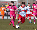 Airdrie's Scott Gray and Stirling's Angus Beith challenge for the ball.