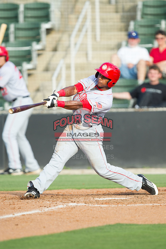 Wilmer Difo (6) of the Hagerstown Suns follows through on his swing against the Kannapolis Intimidators at CMC-Northeast Stadium on May 31, 2014 in Kannapolis, North Carolina.  The Intimidators defeated the Suns 3-2 in game one of a double-header.  (Brian Westerholt/Four Seam Images)