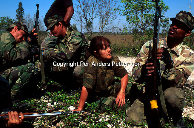 Unidentified Cuban exiles during a military style exercise on August 11, 1993 in Miami Florida, USA. They are members of Alpha 66, a group of Cubans that left Fidel Castro's Cuba about 40 years ago for Florida. They have weapons and fitness training on the weekends in preparation for a possible invasion of Cuba..(Photo: Per-Anders Pettersson/ Getty Images)