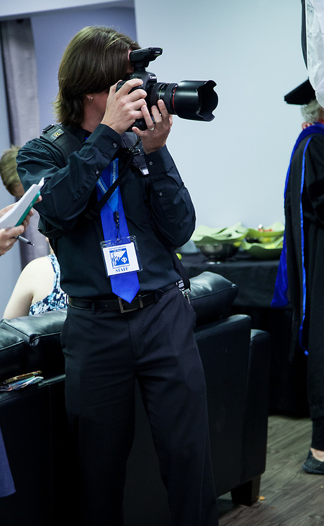 Jeff Carrion, digital media specialist, takes photos of honorary degree recipients backstage Saturday, June 10, 2017, at the Rosemont Theatre in Rosemont, IL. The Rev. Dennis H. Holtschneider, C.M., president of DePaul, conferred the degrees. (DePaul University/Arielle Toub)