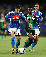 25th July 2020; Stadio San Paolo, Naples, Campania, Italy; Serie A Football, Napoli versus Sassuolo; Eljif Elmas of Napoli holds off  the challenge from Junior Trarre US Sassuolo