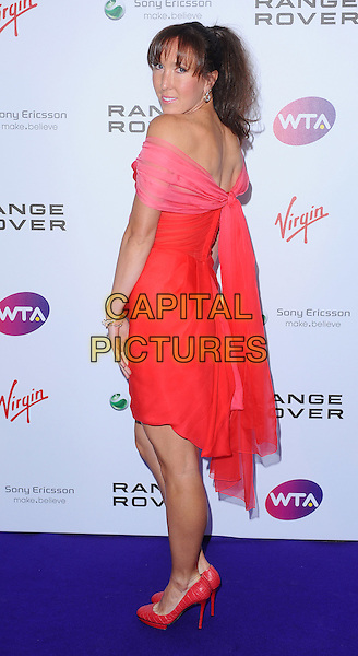 Jelena Jankovic .The WTA Tour Pre-Wimbledon Party, The Roof Gardens, Kensington, London, England..16th June 2011.full length dress looking over off the shoulder shoes red pink smiling .CAP/BEL.©Tom Belcher/Capital Pictures.
