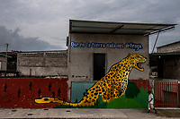 MEXICO - OCTOBER 16: Graffiti that reads &quot;nothing on earth stops us&quot; is seen on a wall near the point where migrants cross the river Suchiate that intersects the Hidalgo/Tecun Uman Mexican border crossing with Guatemala on the 16th of October, 2015 in Ciudad Hidalgo, Mexico. <br /> Daniel Berehulak for The New York Times