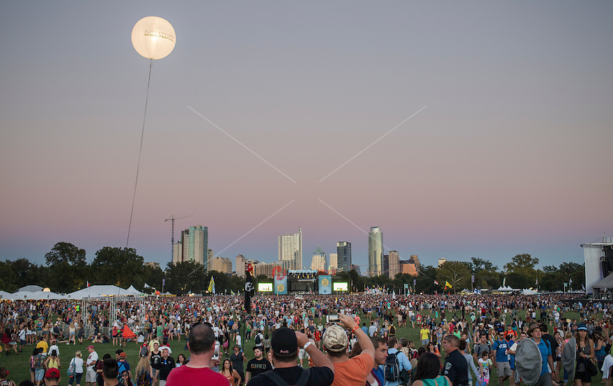 Austin, Texas - October 12: A giant ACL helium ballon lights up the night sky during the Austin City Limits Music Festival overlooking the Austin skyline on October 12, 2014.<br /> <br /> Release Information: Editorial Use Only.<br /> Use of this image in advertising or for promotional purposes is prohibited.