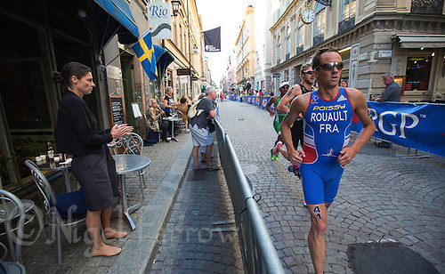 25 AUG 2013 - STOCKHOLM, SWE - Grégory Rouault  (FRA) of France runs through the streets of Gamla Stan, the old part of Stockholm, Sweden, during the elite men's ITU 2013 World Triathlon Series round (PHOTO COPYRIGHT © 2013 NIGEL FARROW, ALL RIGHTS RESERVED)