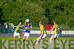 Glenflesk's Alan Mac Sweeney holds the ball as Finuge's Paul Galvin challenges.