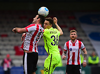 Lincoln City's Matt Rhead vies for possession with York City's Daniel Parslow<br /> <br /> Photographer Andrew Vaughan/CameraSport<br /> <br /> Buildbase FA Trophy Semi Final Second Leg - Lincoln City v York City - Saturday 18th March 2017 - Sincil Bank - Lincoln<br />  <br /> World Copyright &copy; 2017 CameraSport. All rights reserved. 43 Linden Ave. Countesthorpe. Leicester. England. LE8 5PG - Tel: +44 (0) 116 277 4147 - admin@camerasport.com - www.camerasport.com