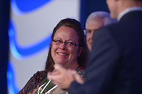 Washington, DC - September 25, 2015: Rowan County, Kentucky clerk Kim Davis gets emotional during an award presentation at the Values Voter Summit at the Omni Shoreham Hotel in the District of Columbia, September 25, 2015. Rowan made headlines when she refused to issue marriage licenses to same-sex couples based on her religious beliefs. Her refusal resulted in a judge putting her in jail for contempt of court. (Photo by Don Baxter/Media Images International)