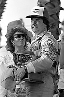 LONG BEACH, CA - APRIL 13: Michael Andretti celebrates in Victory Lane after winning the Toyota Grand Prix of Long Beach CART Indy Car race on the temporary Long Beach Street Circuit in Long Beach, California, on April 13, 1986.