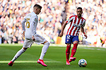 Fede Valverde of Real Madrid and Renan Lodi of Atletico de Madrid during La Liga match between Real Madrid and Atletico de Madrid at Santiago Bernabeu Stadium in Madrid, Spain. February 01, 2020. (ALTERPHOTOS/A. Perez Meca)
