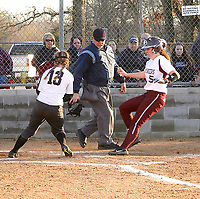 Westside Eagle Observer/RANDY MOLL<br /> Gentry's Carissa Goosens makes it home while Siloam Springs' pitcher Jessie Robinson covers during play on Thursday (March 1, 2018) at Gentry High School.