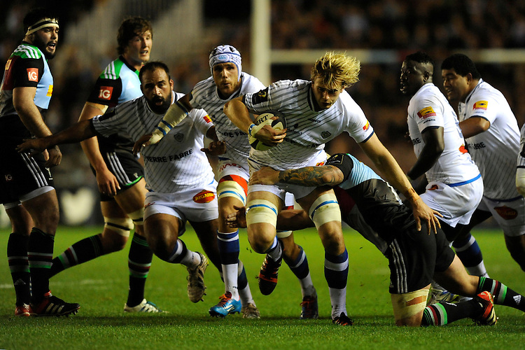 Richie Gray of Castres Olympique breaks in midfield to force his way through Joe Marler of Harlequinsduring the European Rugby Champions Cup  Round 1 match between Harlequins and Castres Olympique at the Twickenham Stoop on Friday 17th October 2014 (Photo by Rob Munro)